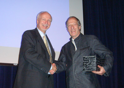 Dean Dr. Eric Hickey giving Professor Canter the Life Time Achievement Award on behalf of Alliant University, California